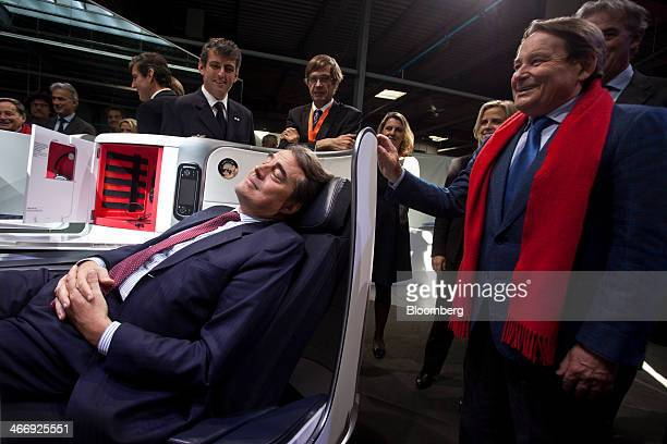 Alexandre de Juniac chief executive officer of Air FranceKLM Group pretends to relax in a new business class seat during a presentation of new...