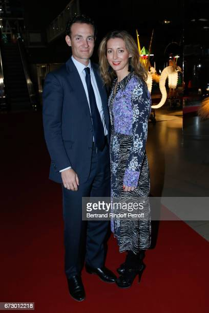 Alexandre de Rothschild and his wife Olivia de Rothschild pose in front the works of JeanPaul Goude during the 'Societe des Amis du Musee d'Art...
