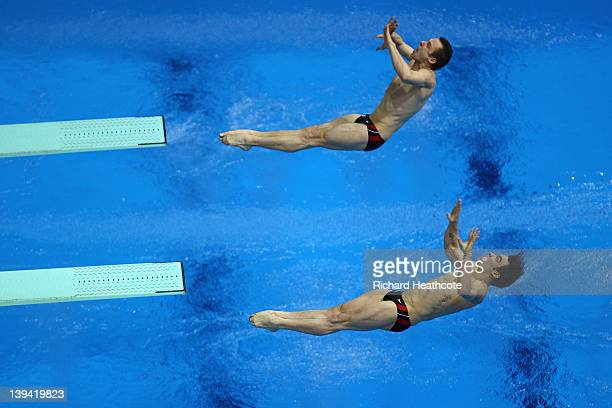 Alexandre Despatie and Reuben Ross of Canada compeate in the Men's Synchronised 3m Springboard Final during the 18th FINA Visa Diving World Cup at...