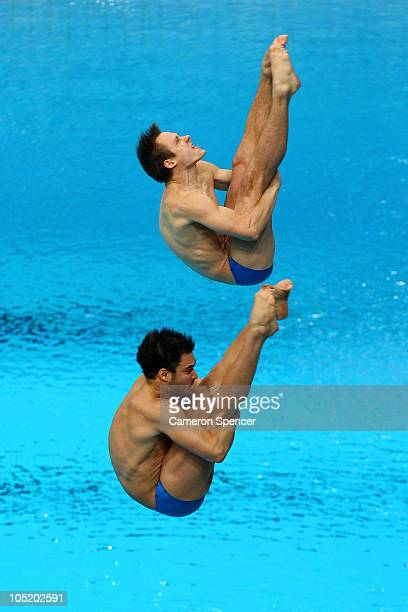 Alexandre Despatie and Reuben Ross of Canada compete in the Men's 3m Synchro Springboard Final at Dr SP Mukherjee Aquatics Complex on day nine of the...