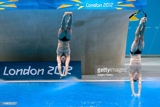 Alexandre Despatie and Reuben Ross of Canada react as they compete in the Men's Synchronised 3m Springboard Diving on Day 5 of the London 2012...