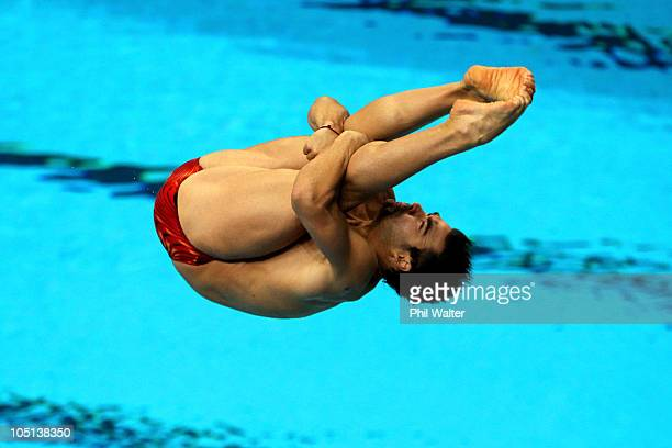 Alexandre Despatie of Canada competes in the Men's 3m Springboard Preliminary at Dr SP Mukherjee Aquatics Complex during day eight of the Delhi 2010...