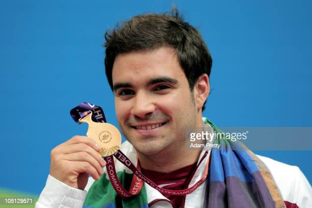 Alexandre Despatie of Canada poses with the gold medal won in the Men's 1m Springboard Final at the Dr SP Mukherjee Aquatics Complex during day seven...