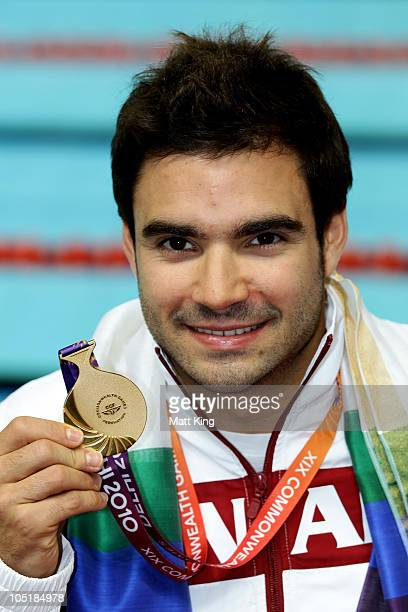 Alexandre Despatie of Canada poses with the gold medal won in the Men's 3m Springboard Final at Dr SP Mukherjee Aquatics Complex during day eight of...
