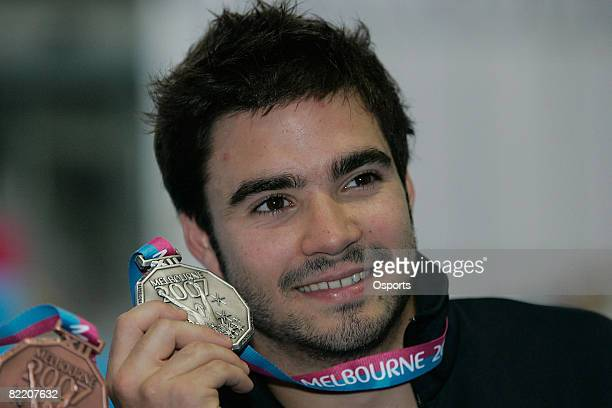 Alexandre Despatie of Canada poses with the silver medal after the Men's 3m Springboard Final event during the 12th FINA World Championships at the...