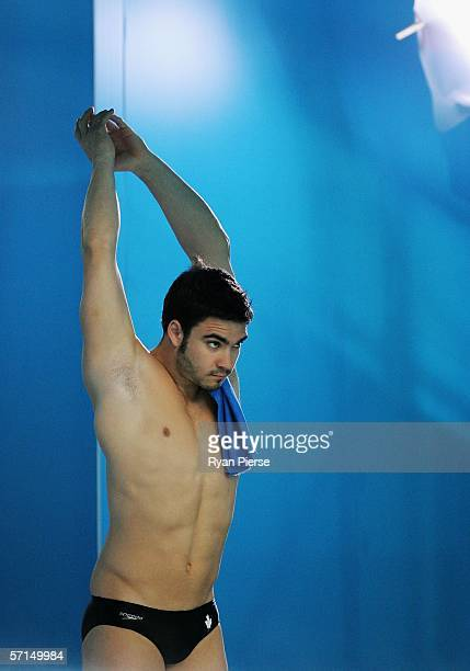 Alexandre Despatie of Cananda prepares to dive in the Men's 1m Springboard Preliminary round during the diving at the Melbourne Sports Aquatic Centre...