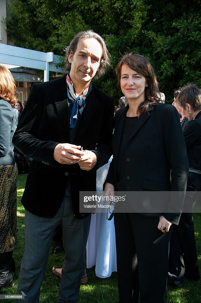 Alexandre Desplat and Ursula Meier attends The Consul General Of France, Mr. Axel Cruau, reception in Honor of The French Nominees For The 85th Annual Academy Awards at French Consulate's Home on February 25, 2013 in Beverly Hills, California.