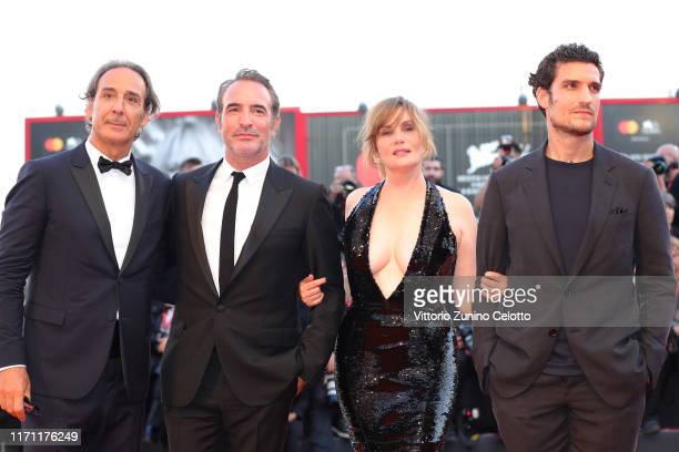 Alexandre Desplat Jean Dujardin Emmanuelle Seigner and Louis Garrel walk the red carpet ahead of the J'Accuse screening during the 76th Venice Film...
