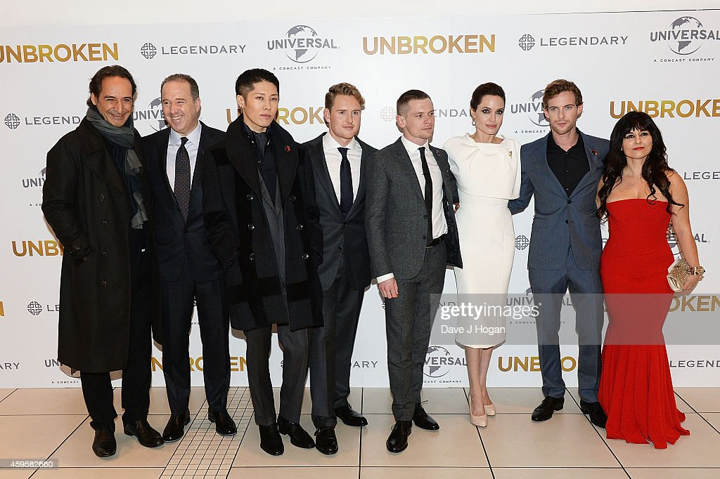 Alexandre Desplat, Matthew Baer, Miyavi, Ross Anderson, Jack O'Connell, Angelina Jolie, Luke Treadaway and Maddalena Ischiale attend the UK Premiere of 'Unbroken' at Odeon Leicester Square on November 25, 2014 in London, England.