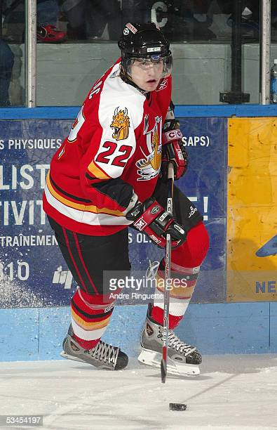 Alexandre Dulac-Lemelin of the Baie-Comeau Drakkar handles the puck against the Gatineau Olympiques at Centre Robert-Guertin on November 19, 2004 in...