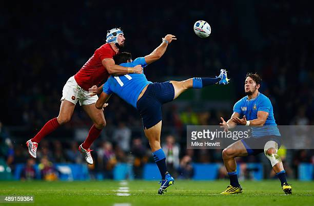 Alexandre Dumoulin of France Giovanbattista Venditti of Italy and Andrea Masi of Italy challenge for the high ball during the 2015 Rugby World Cup...