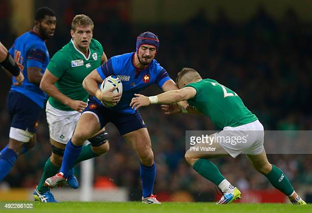 Alexandre Dumoulin of France hands off Ian Madigan of Ireland during the 2015 Rugby World Cup Pool D match between France and Ireland at Millennium...