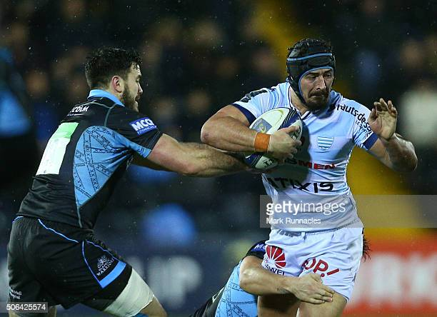 Alexandre Dumoulin of Racing 92 is tackled by Alex Dunbar of Glasgow Warriors during the European Rugby Champions Cup pool 3 match between Glasgow...