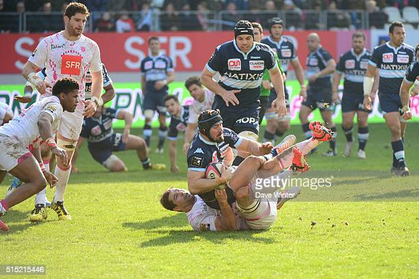 Alexandre Dumoulin of Racing 92 is tackled by Willem Alberts of Stade Francais Paris during the French Top 14 rugby union match between Stade...