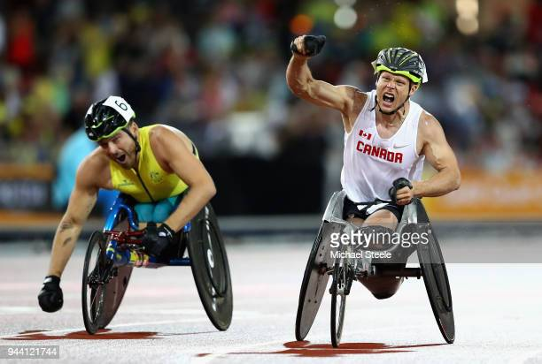 Alexandre Dupont of Canada celebrates winning gold ahead of Kurt Fearnley of Australia in the Men's T54 1500 metres during the Athletics on day six...