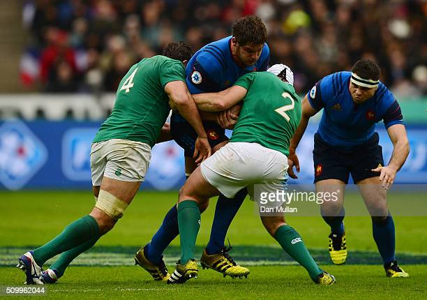 Alexandre Flanquart of France is tackled by Mike McCarthy and Rory Best of Ireland during the RBS Six Nations match between France and Ireland at the...