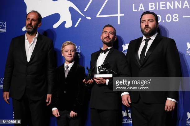 Alexandre Gavras Thomas Gioria Xavier Legrand and Denis Menochet pose with the Silver Lion for Best Director Award for 'Jusqu'à la Garde' and the...