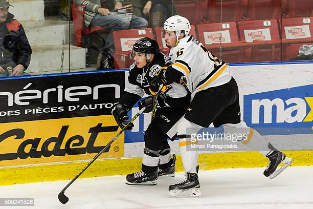 Alexandre Gosselin of the Cape Breton Screaming Eagles holds onto Samuel Tremblay of the BlainvilleBoisbriand Armada during the QMJHL game at the...