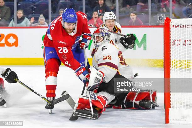 Alexandre Grenier of the Laval Rocket about to deke JeanFrancois Berube of the Cleveland Monsters at Place Bell on January 19 2019 in Laval Quebec