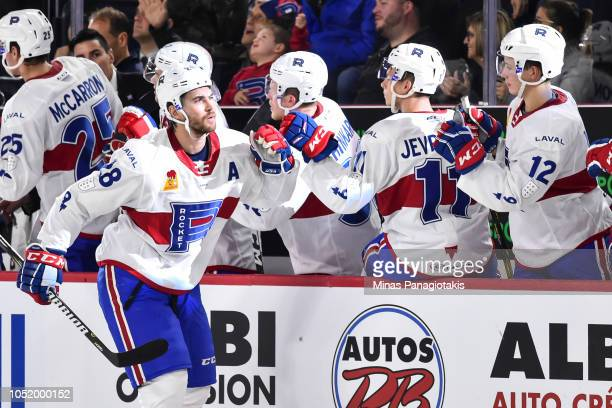 Alexandre Grenier of the Laval Rocket celebrates a first period goal with teammates on the bench against the Binghamton Devils during the AHL game at...