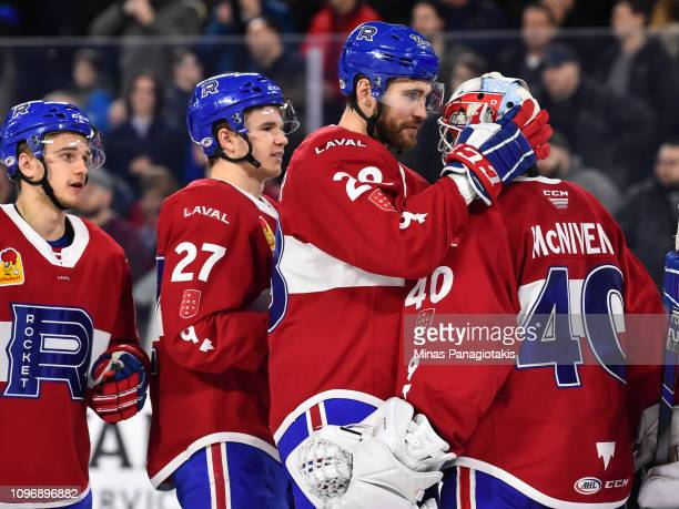 Alexandre Grenier of the Laval Rocket congratulates goaltender Michael McNiven for their victory against the Cleveland Monsters during the AHL game...