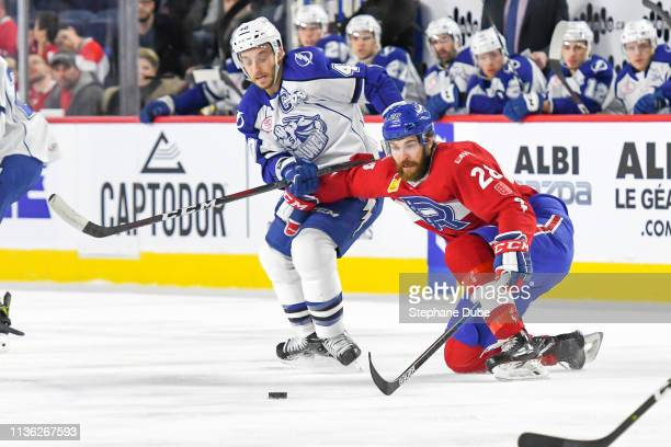 Alexandre Grenier of the Laval Rocket fights for the puck against Gabriel Dumont of the Syracuse Crunch at Place Bell on March 13 2019 in Laval Quebec