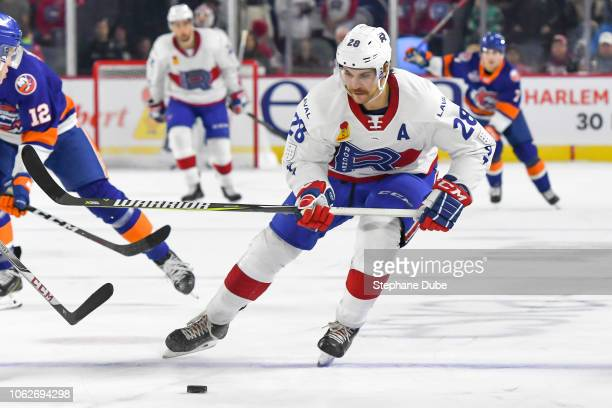 Alexandre Grenier of the Laval Rocket in control of the puck against the Bridgeport Sound Tigers at Place Bell on November 16 2018 in Laval Quebec
