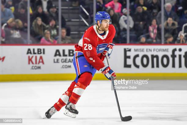 Alexandre Grenier of the Laval Rocket in control of the puck against the Belleville Senators at Place Bell on January 2 2019 in Laval Quebec