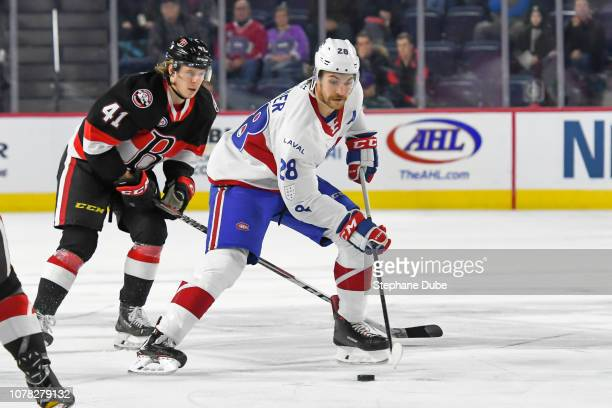 Alexandre Grenier of the Laval Rocket in control of the puck ahead of Filip Chlapik of the Belleville Senators at Place Bell on November 28 2018 in...