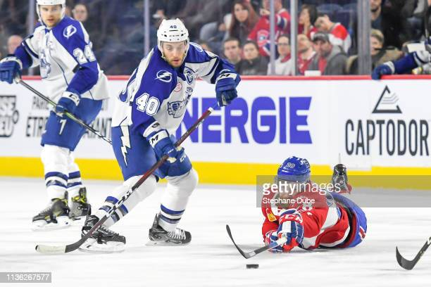 Alexandre Grenier of the Laval Rocket on the ice fighs for the puck against Gabriel Dumont of the Syracuse Crunch at Place Bell on March 13 2019 in...