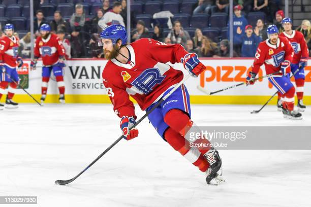 Alexandre Grenier of the Laval Rocket shifting sides during warmup against the Syracuse Crunch at Place Bell on March 13 2019 in Laval Quebec
