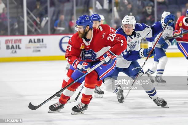Alexandre Grenier of the Laval Rocket waiting for a pass while Mitchell Stephens of the Syracuse Crunch is close behind at Place Bell on March 13...