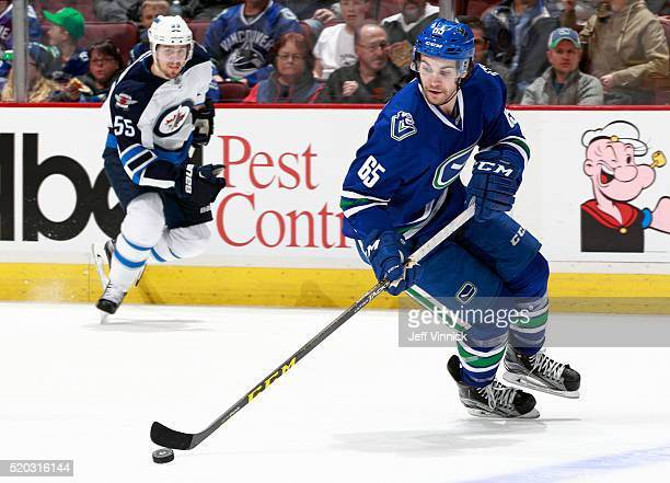 Alexandre Grenier of the Vancouver Canucks and Mark Scheifele of the Winnipeg Jets skate up ice during their NHL game at Rogers Arena March 14 2016...