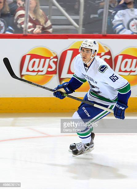 Alexandre Grenier of the Vancouver Canucks follows the play down the ice during second period action against the Winnipeg Jets at the MTS Centre on...