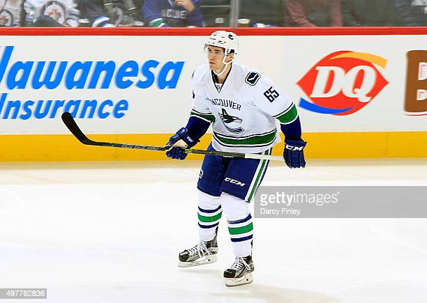 Alexandre Grenier of the Vancouver Canucks keeps an eye on the play during second period action against the Winnipeg Jets at the MTS Centre on...