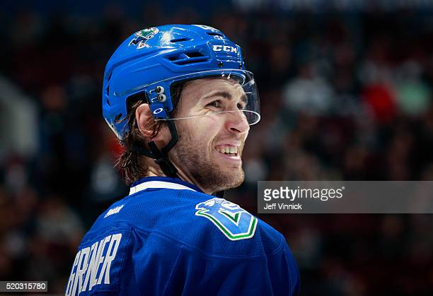 Alexandre Grenier of the Vancouver Canucks looks on from the bench during their NHL game against the Winnipeg Jets at Rogers Arena March 14 2016 in...