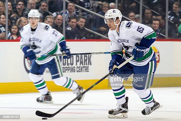 Alexandre Grenier of the Vancouver Canucks plays the puck up the ice during first period action against the Winnipeg Jets at the MTS Centre on...