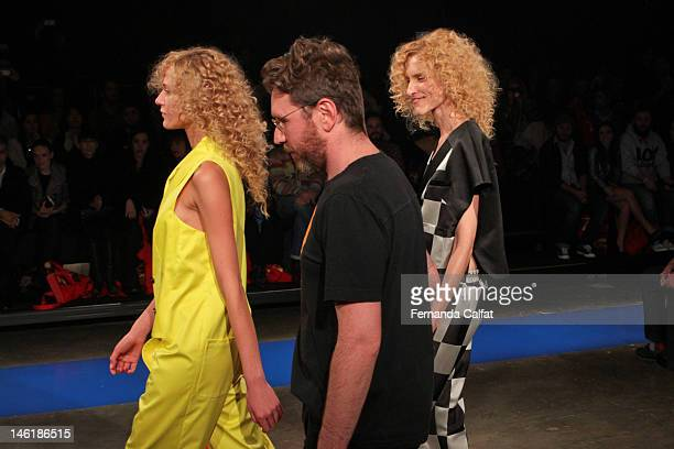 Alexandre Herchcovitch Gianini Marques and Alicia Kuczman walk the runway during the Alexandre Herchcovitch show during Sao Paulo Fashion Week...