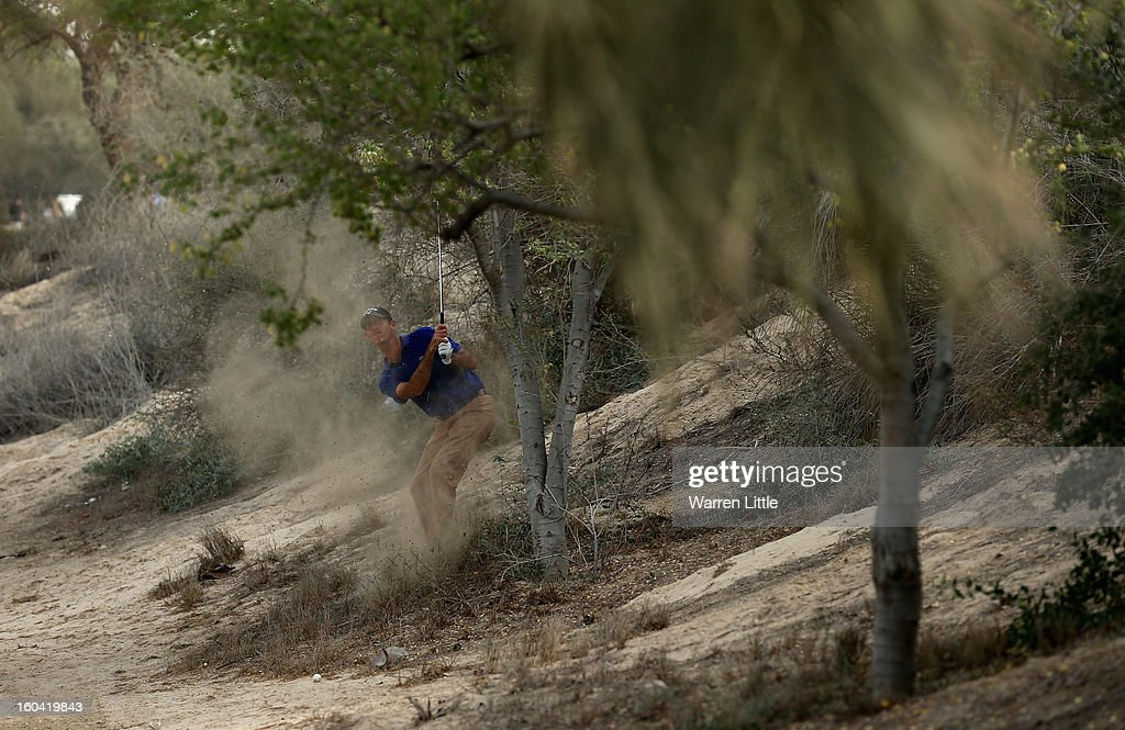 Alexandre Kaleka of France plays out of the bush during the first round of the Omega Dubai Desert Classic at Emirates Golf Club on January 31, 2013 in Dubai, United Arab Emirates.