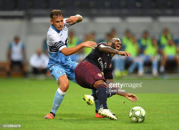 Alexandre Lacazeet of Arsenal is challenged by Alessandro Murgia of Lazio during the Preseason friendly between Arsenal and SS Lazzio on August 4...
