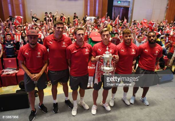 Alexandre Lacazette Alex OxladeChamberlain Mesut Ozil Francis Coquelin Nacho Monreal and Emiliano Martinez attend an Arsenal Fan Party at the...