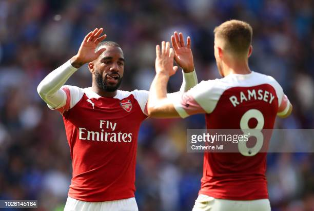 Alexandre Lacazette and Aaron Ramsey of Arsenal celebrate victory after the Premier League match between Cardiff City and Arsenal FC at Cardiff City...