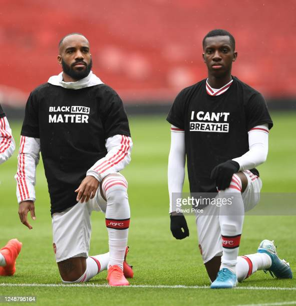 Alexandre Lacazette and Eddie Nketiah of Arsenal take a knee in support of Black Lives Matter before the friendly match between Arsenal and Brentford...