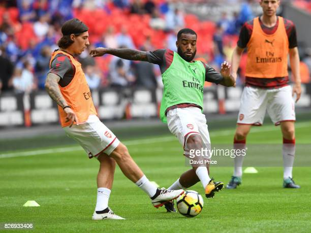 Alexandre Lacazette and Hector Bellerin of Arsenal warms up before the match between Chelsea and Arsenal at Wembley Stadium on August 6 2017 in...