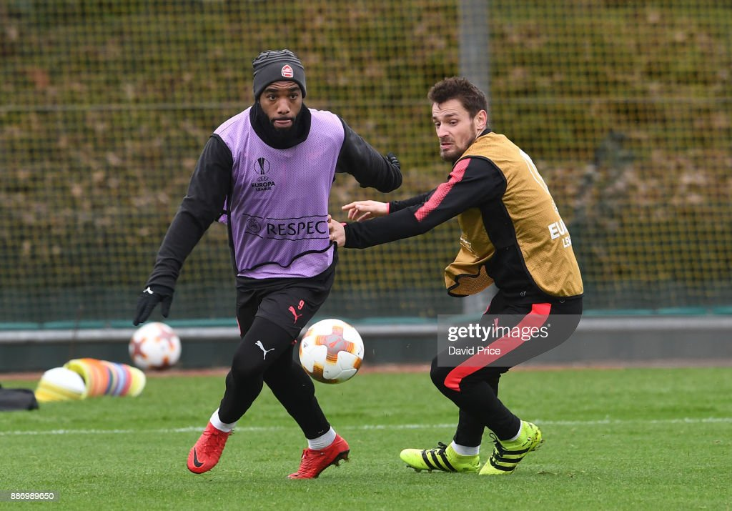 Alexandre Lacazette and Mathieu Debuchy of Arsenal during the Arsenal training session, on the eve of the UEFA Europa League group H match against BATE Borisov, at London Colney on December 6, 2017 in St Albans, England.