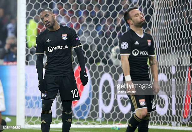 Alexandre Lacazette and Mathieu Valbuena of Lyon react during the UEFA Champions League match between Olympique Lyonnais and Sevilla FC at Parc OL on...