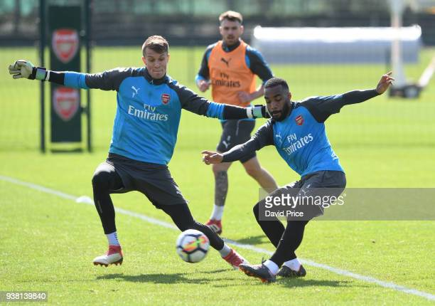 Alexandre Lacazette and Matt Macey of Arsenal during the 1st team training session at London Colney on March 26 2018 in St Albans England