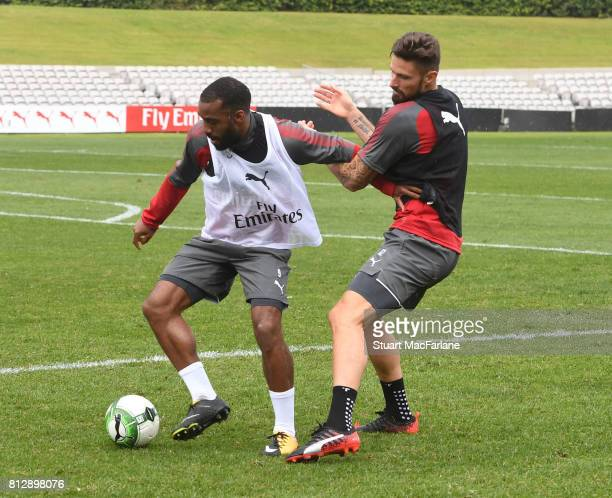 Alexandre Lacazette and Olivier Giroud of Arsenal during a training session at the Koraragh Oval on July 12 2017 in Sydney Australia