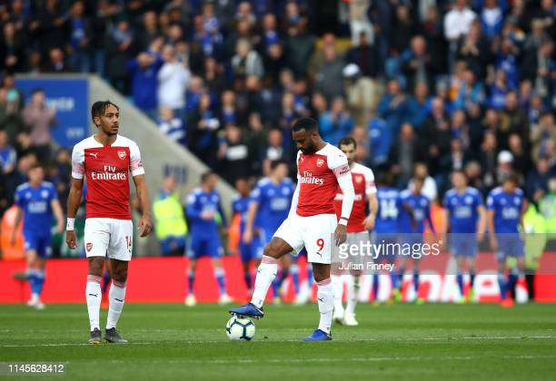 Alexandre Lacazette and PierreEmerick Aubameyang of Arsenal react after Leicester City score their first goal during the Premier League match between...