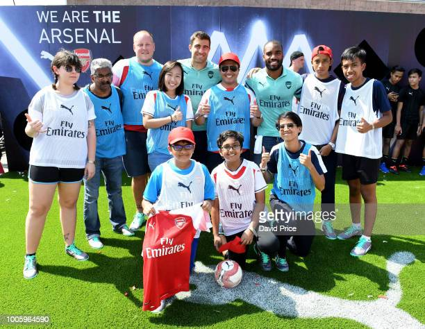 Alexandre Lacazette and Sokratis Papastathopouplos of Arsenal launch the new Arsenal Puma 3rd kit at Esplande Theatres on the Bay on July 27 2018 in...
